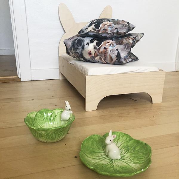green food bowls and rabbit bed