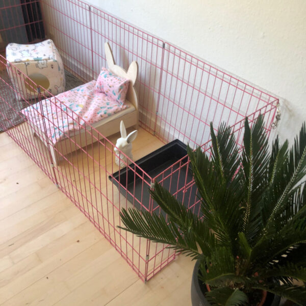 pink rabbit enclosure, rabbit bed and fleece blanket
