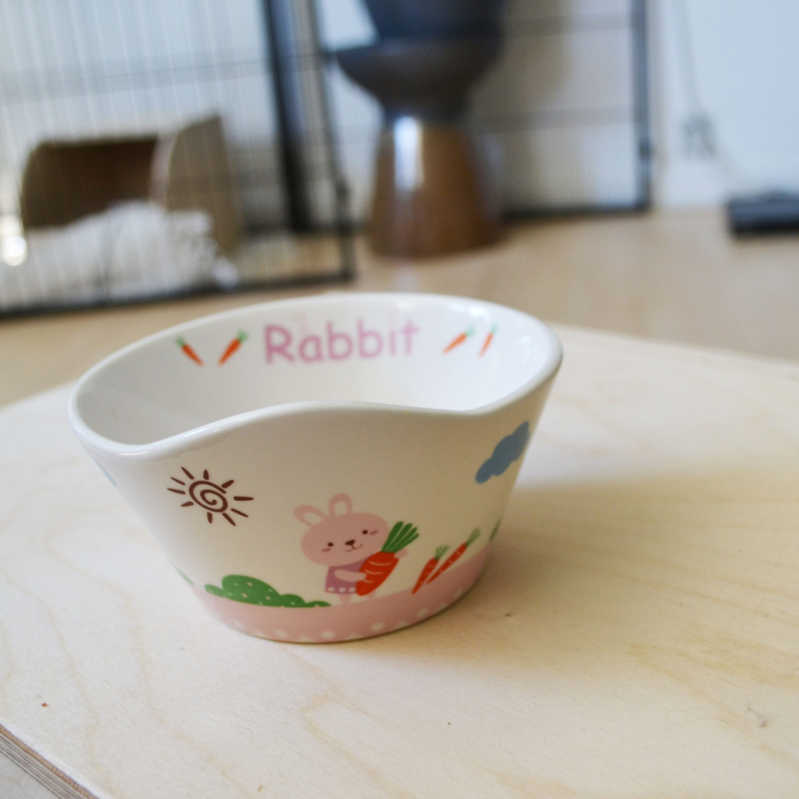 pink food bowl with rabbit and flowers
