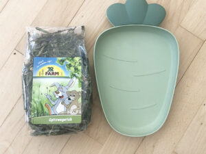 large food bowl and treats for rabbits
